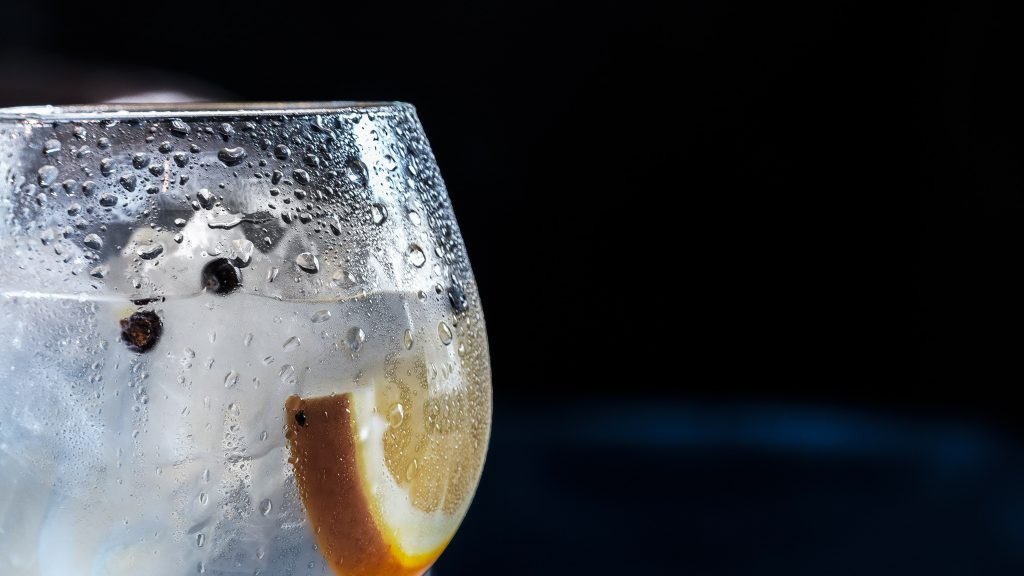Water with lemon and ice in a glass